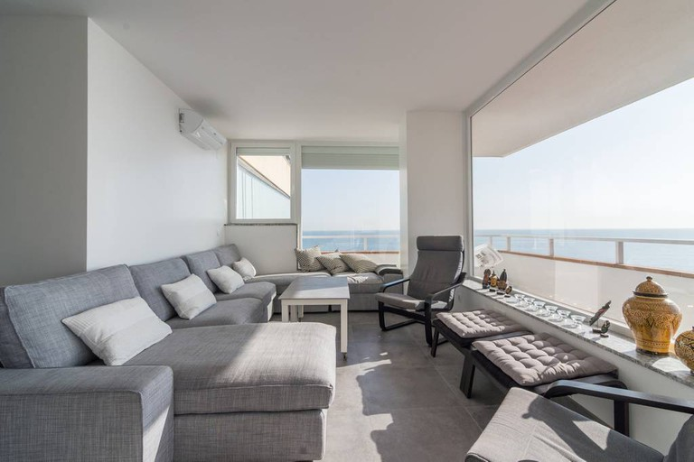 Enjoy beachfront views from this modern apartment