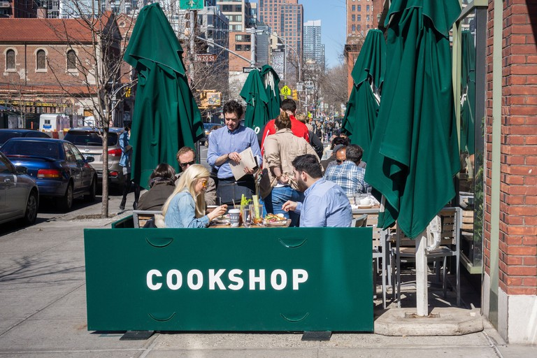 Busy al fresco dining at the sidewalk cafe of Cookshop restaurant in the New York neighborhood of the Chelsea