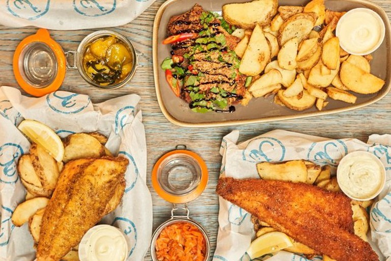 A selection of Hook's new-school fish and chips in Japanese panko breadcrumbs and tempura batter sit on a table
