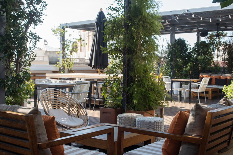 Hotel Pulitzer's rooftop terrace hosts DJs and live music throughout the summer