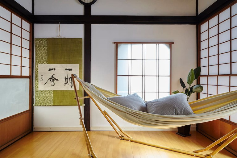 Hammocks and other cosy amenities adorn this abode