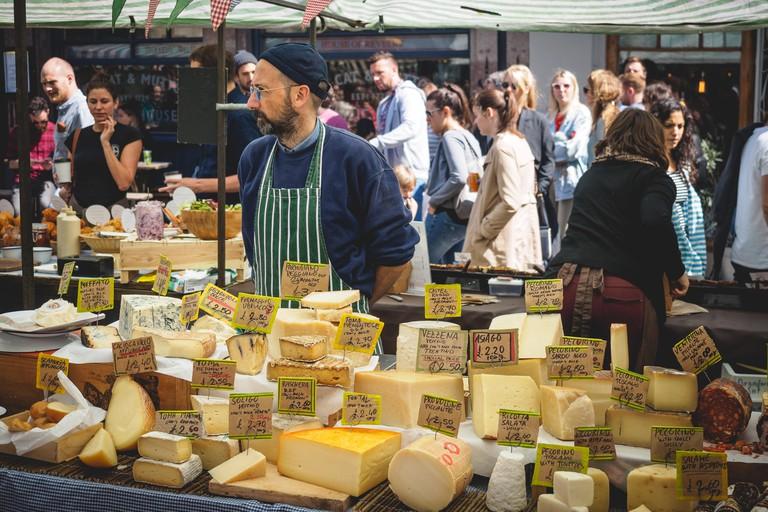 Street food stall selling cheese in Broadway Market in Hackney. East London (UK), August 2017. Landscape format.