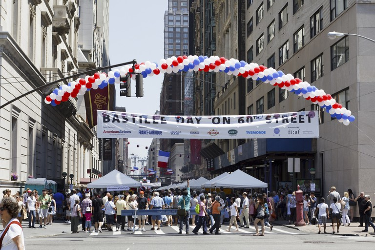 The Bastille Day on 60th Street street fair as seen from 5th Avenue, New York, NY, USA.
