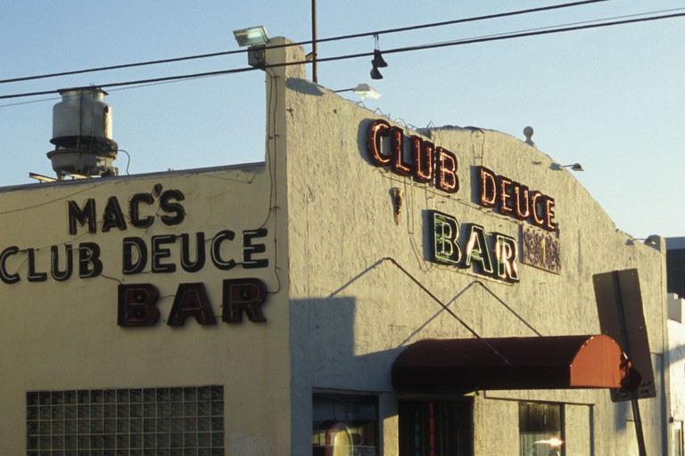 Long-time patrons gather at Mac's Club Deuce Bar for cheap drinks and familiar faces