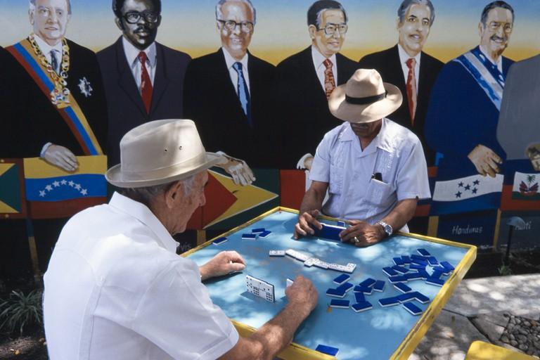 Latin men playing dominos at Domino Park, Little Havana, Miami.