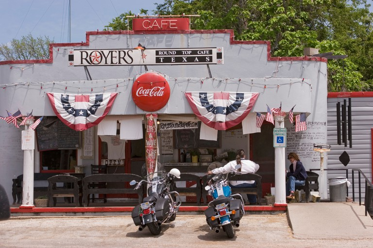 Motorcycles parked outside the Royers Round Top Cafe in Texas. Image shot 2005. Exact date unknown.