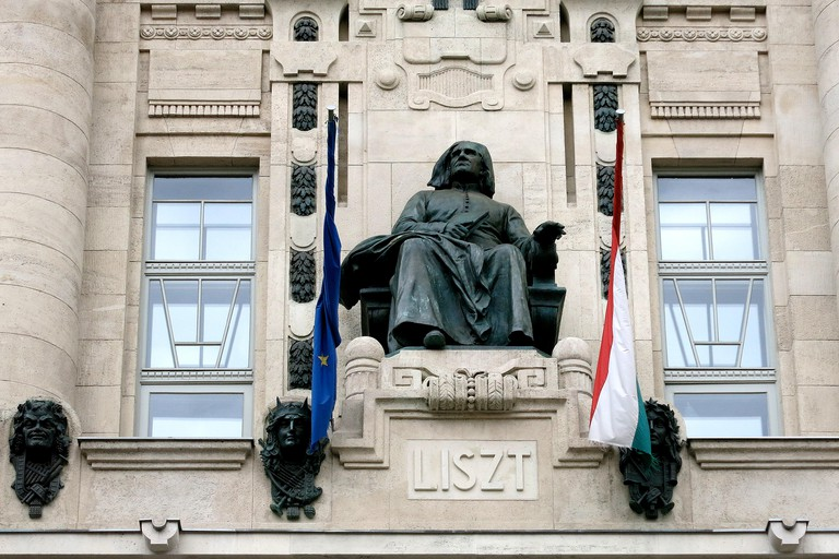 Ferenc Liszt statue on the facade of Magyar Kiralyi Zeneakademia, Budapest.