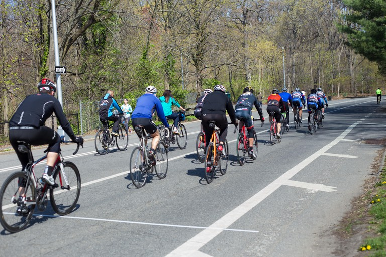 View of cyclists riding along bike lane in Prospect Park Brooklyn.