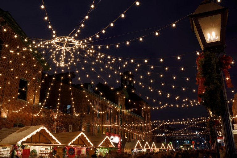 Lights strung over Trinity Street historic Distillery District for the Toronto Christmas Market