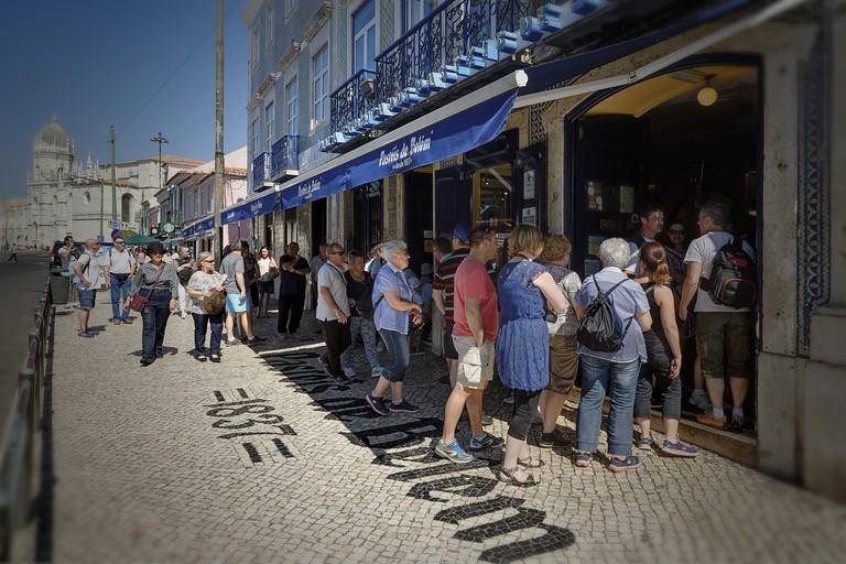 People queue outside Pasteis de Belem in Lisbon