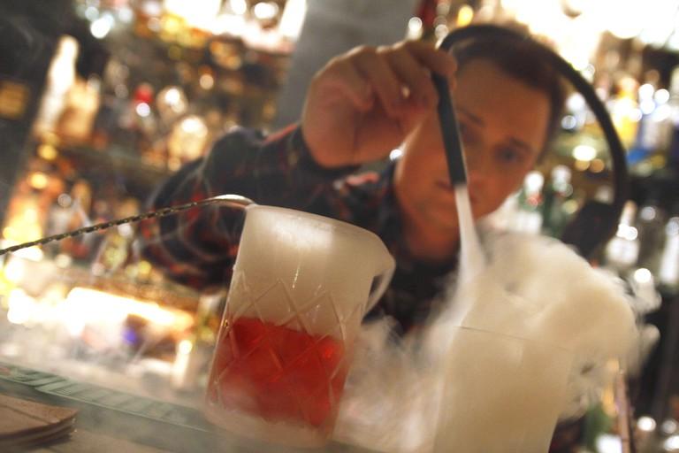 A bartender prepares cocktails in the Zephyr Bar at Baaderstrasse 68.