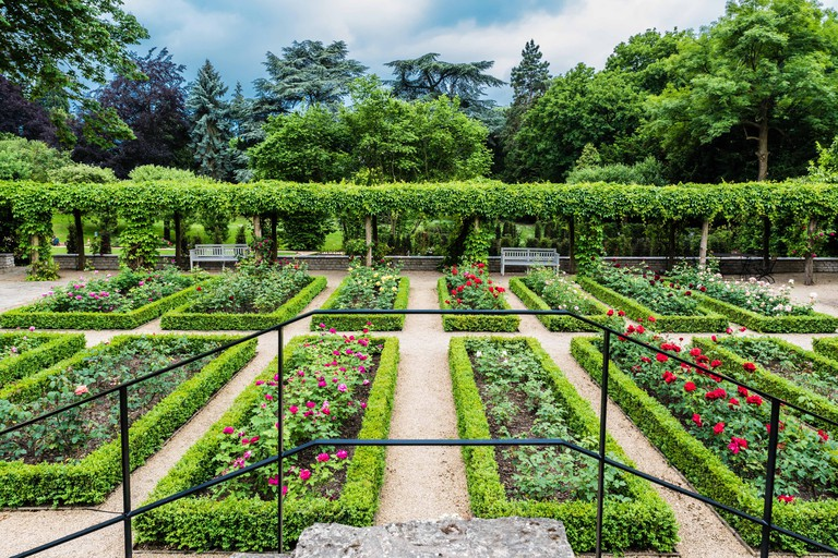 View over the panoramic landscape gardens of the Van Buuren Museum in Uccle, Brussels, Belgium in spring