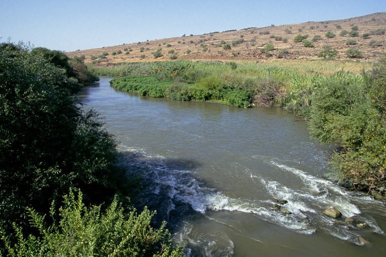 A view of the Jordan River as it flows through the desert in Israel.