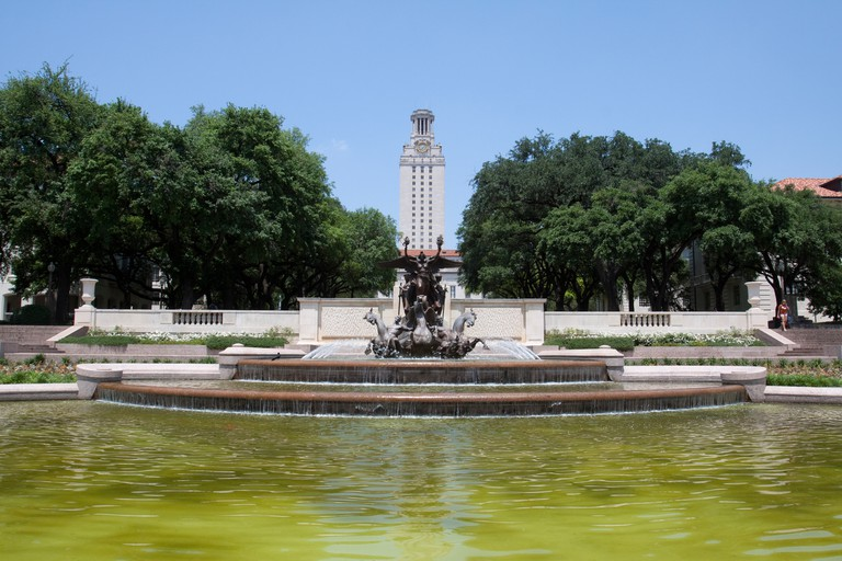 Littlefield Memorial Fountain in front of the University of Texas Tower in Austin, Texas, USA.