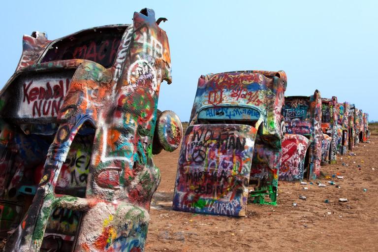 Graffiti covered Cadillacs at Cadillac Ranch along Route 66 in Texas