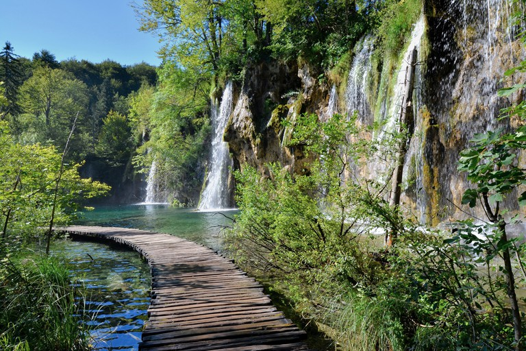 Boardwalk through the waterfalls of Plitvice Lakes National Park, Croatia.