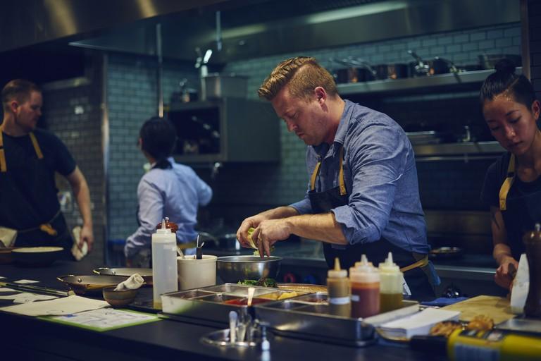 Chef cooking at Otium restaurant
