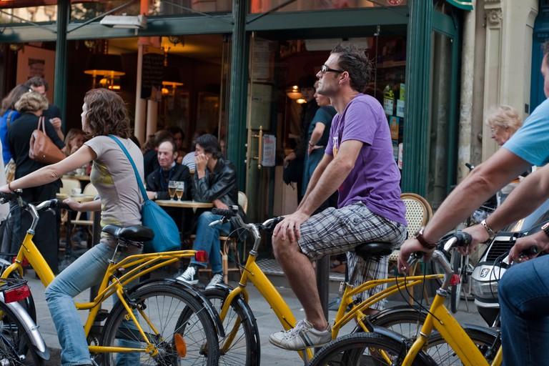 Paris, France, Adult Tourists Visiting Paris by Bicycle Tour, bicycling, Saint Germain des Pres District