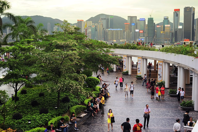 People at Tsim Sha Tsui at sunset.