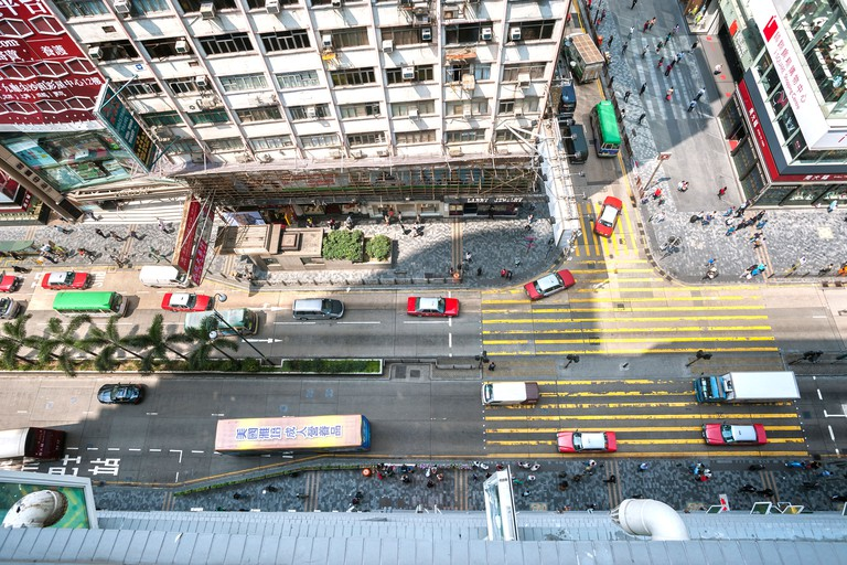 Looking down on a busy Nathan Road from Chungking Mansions, Hong Kong