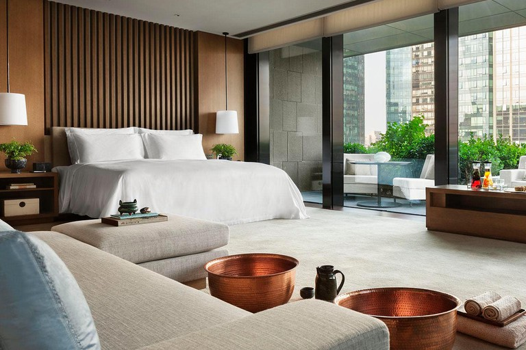 Chic and contemporary guest-rooms are complete with in-room book selections, Rosewood Beijing