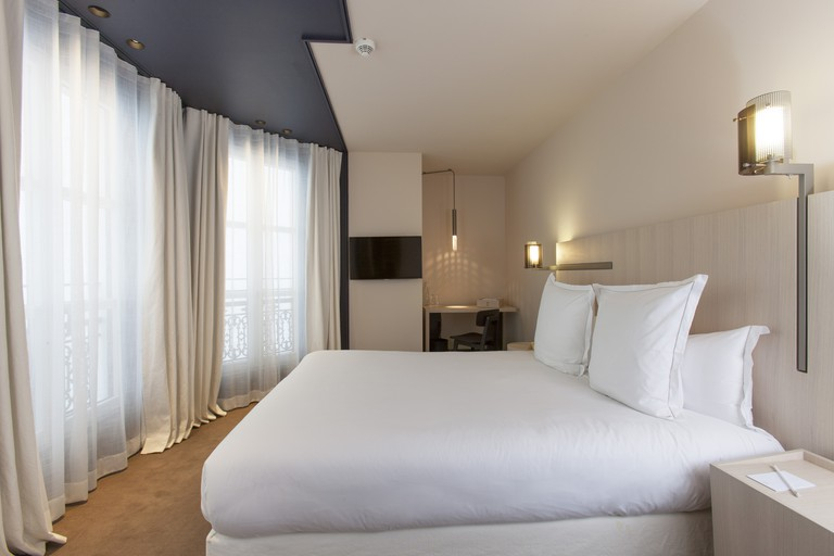Enjoy soothing neutral tones in the Hôtel de Nell's bedrooms
