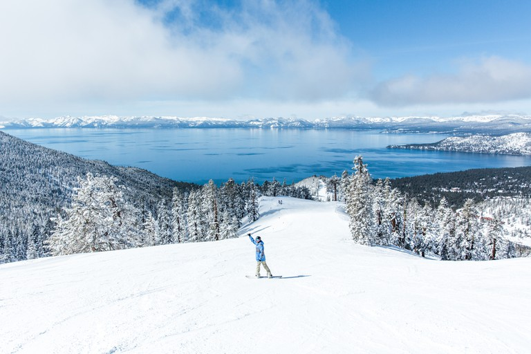 Snowboarders can enjoy Reno Tahoe's majestic, snow-covered mountains