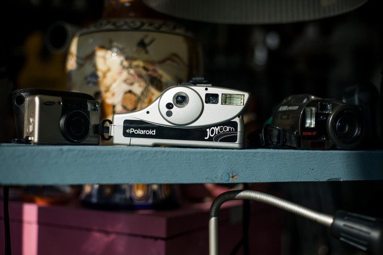 Polaroid Joycam camera displayed in window of second-hand / antique shop