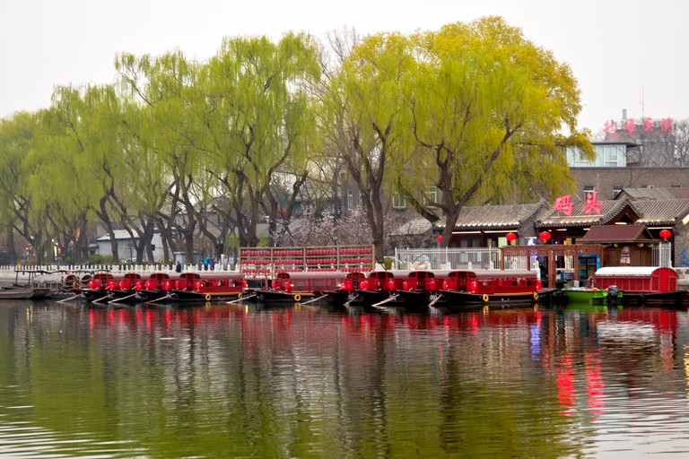 Dinner boats await customers, Shichahai (Houhai) District at Twilight, Beijing, China.