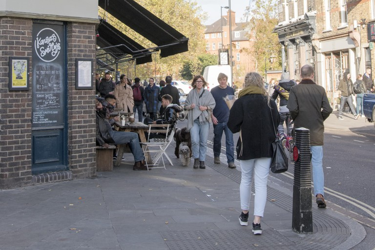 Busy street in front of newly opened Off Broadway bar at Broadway Market, a market in Hackney, East London, United Kingdom, October 29, 2017. ()