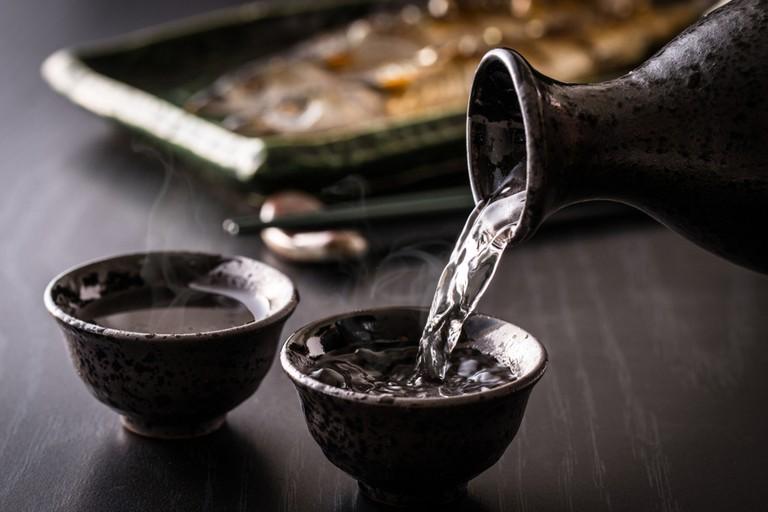 Bartender pouring Japanese sake