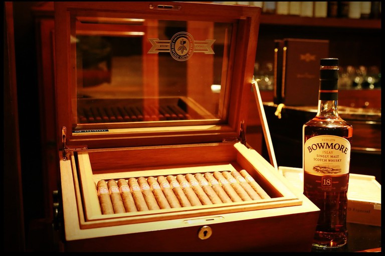 Relax at the cigar lounge with a glass of whiskey