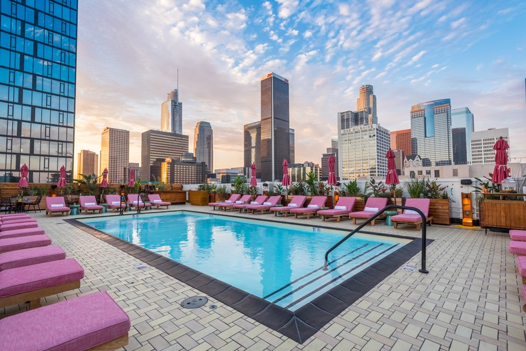 The atmospheric rooftop pool offers gorgeous views of the LA skyline