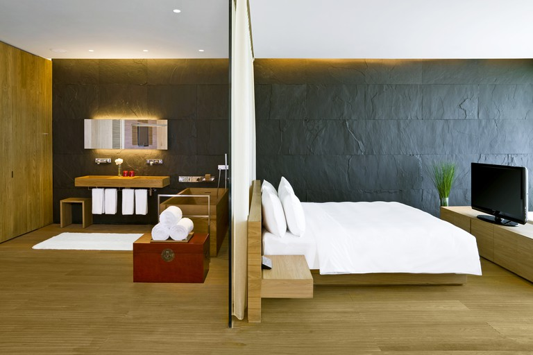 This stylish glassy hotel boasts light and refreshing rooms, The Opposite House, Beijing