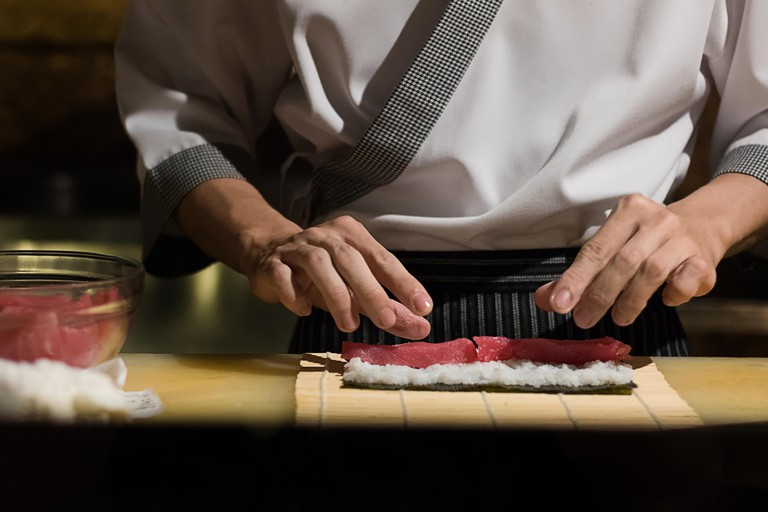 A chef making sushi