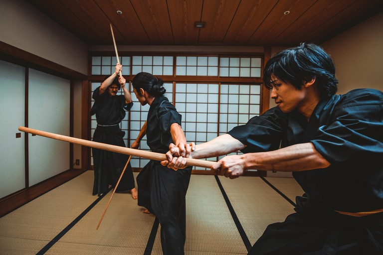 Samurai training in a traditional dojo, in Tokyo