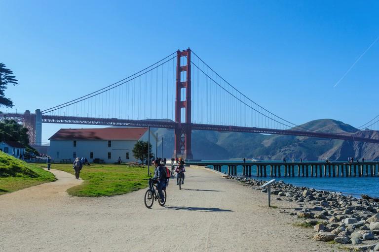 Tourists cycling near the Golden Gate Bridge in San Francisco.