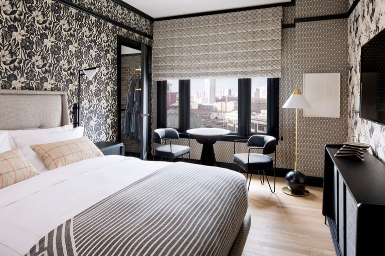 Deluxe King Rooms feature contemporary decor and plush king-size beds, Proper Hotel
