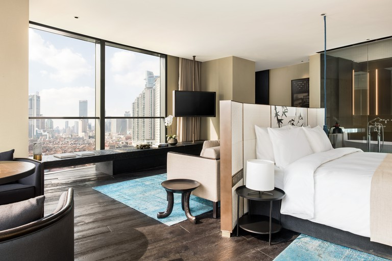 Opt for a Studio 90 room for a real slice of paradise. Set high above the bustling city below, this room comes with a separated living area and a free mini-bar, not to mention the undisturbed views of the city, The Middle House, Shanghai