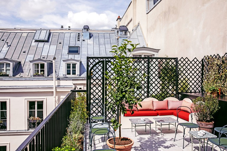 The gorgeous rooftop is a relaxing place to enjoy a drink or two, Hotel des Grand Boulevards