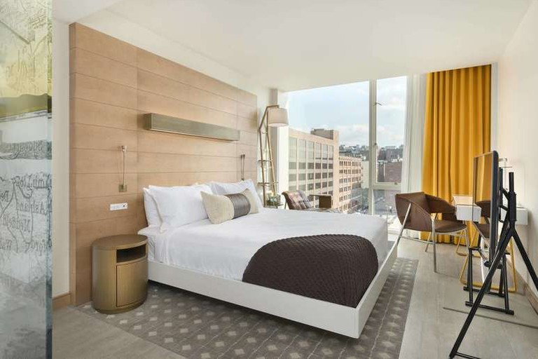 The Envoy Hotel's spacious come with city or river views