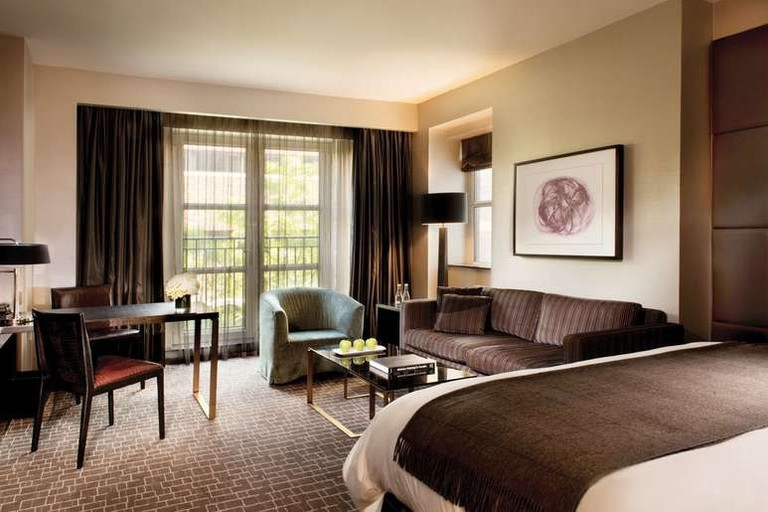 The luxury rooms at The Hazelton Hotel Toronto feature a seating area