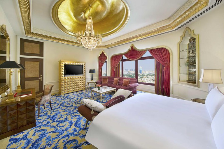 Palatial suites feature lofty ceilings, plush Middle Eastern furnishing, chandeliers and marble bathrooms.
