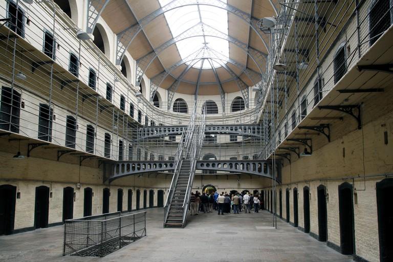 A tour group explores Kilmainham Gaol