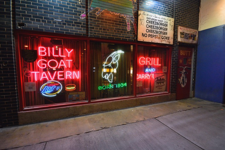 Chicago, IL - July 15, 2017: Famous scene downtown Chicago. The iconic Billy Goat Tavern sign welcomes into the dark Lower Wacker underpass beneath.