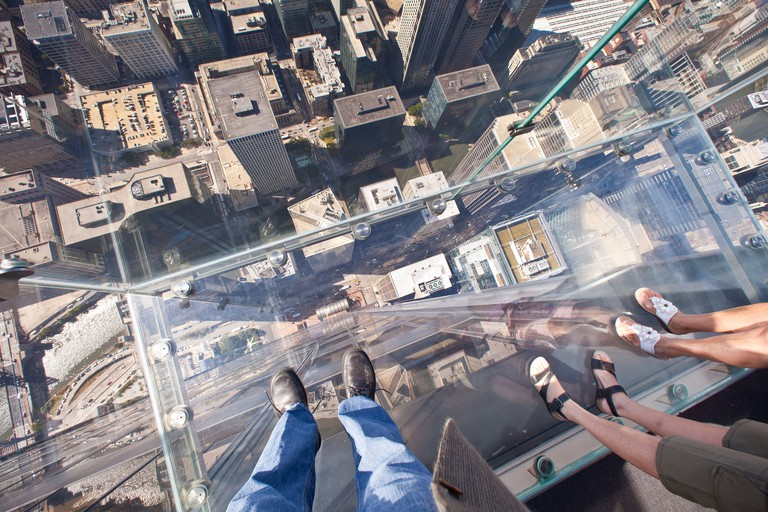 Looking down through the glass balcony Skydeck observation at the Willis Tower Sears Tower in Chicago