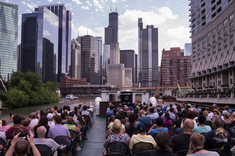 Tourists on an architectural boat tour in Chicago, Illinois