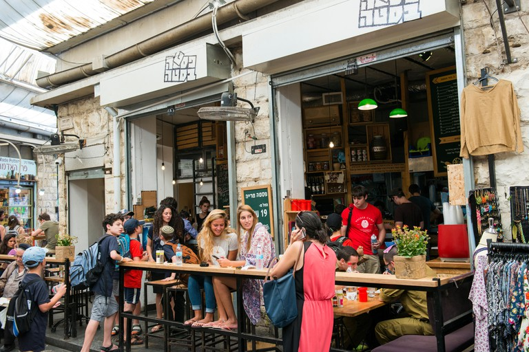 Young people sit in popular restaurants and bars in the Mahane Yehuda market in Jerusalem
