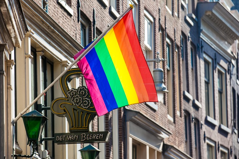 Bet van Beeren Cafe 't Mandje and the LGBT flag at the Old Central district in Amsterdam