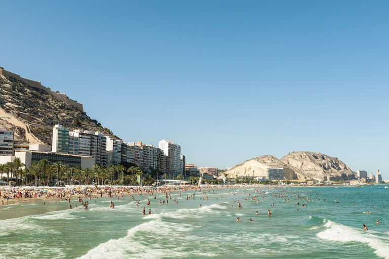 Beachgoers enjoying the summer, Alicante
